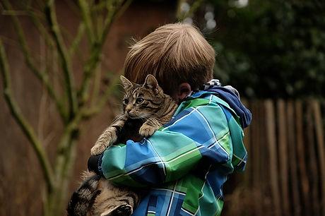 child hugging cat.jpg