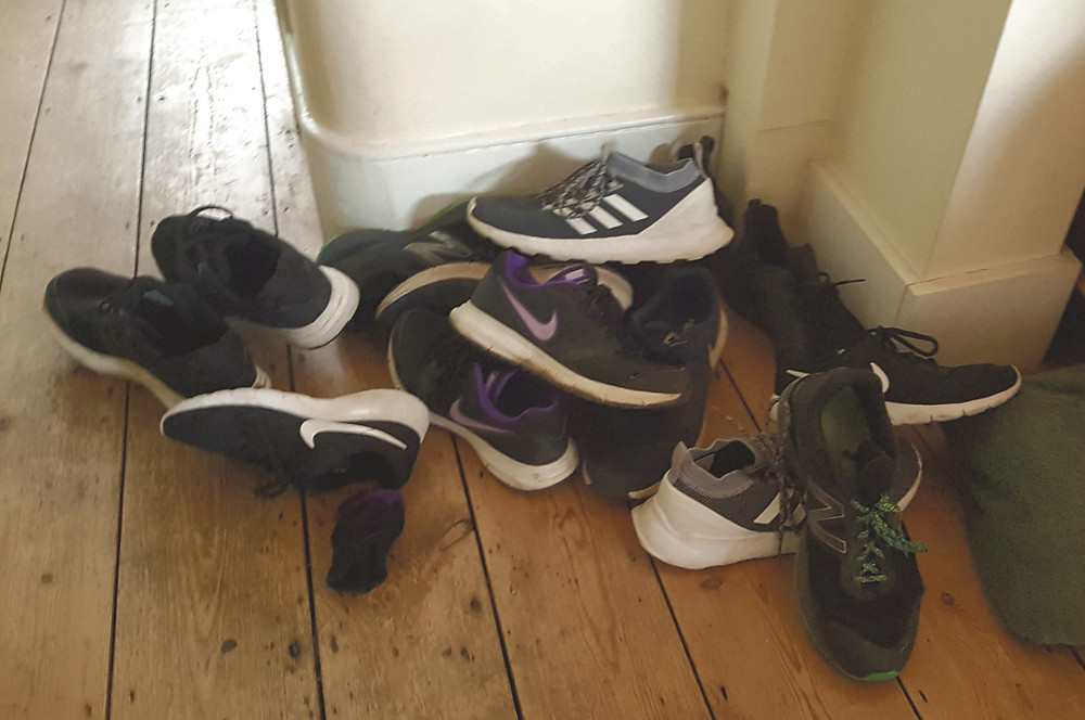 Pile of trainers on the floor