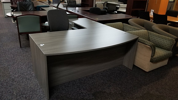 cherryman amber series single pedestal L shaped desk with bow front desk in gray finish