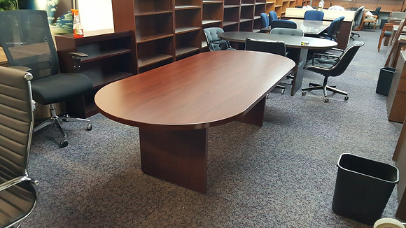8' cherryman racetrack shaped laminate conference table in mahogany finish with matching base