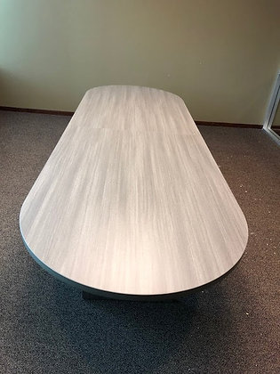 12' cherryman racetrack shaped laminate conference table in gray finish with matching base.