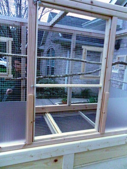 Large back door for servicing cage
