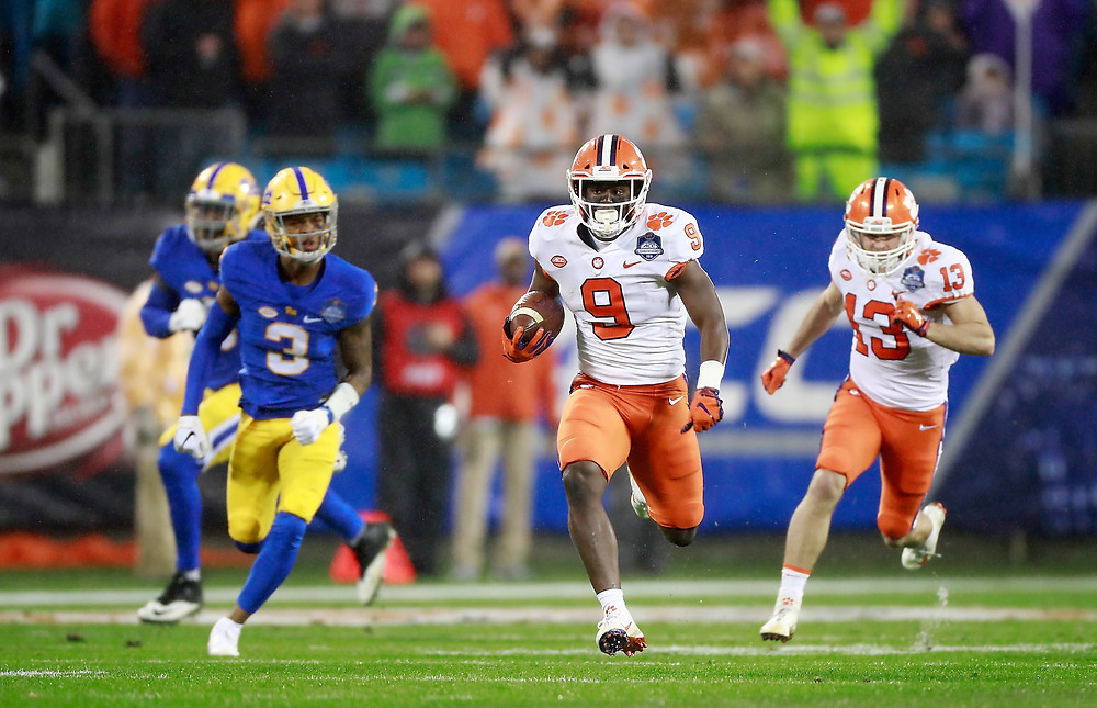 Clemson's running back Travis Etienne (9) runs for a touchdown on the first play of the Dr Pepper ACC Football Championship Game in Charlotte, N.C., Dec. 1, 2018. (Photo by  Jason E. Miczek, the ACC)