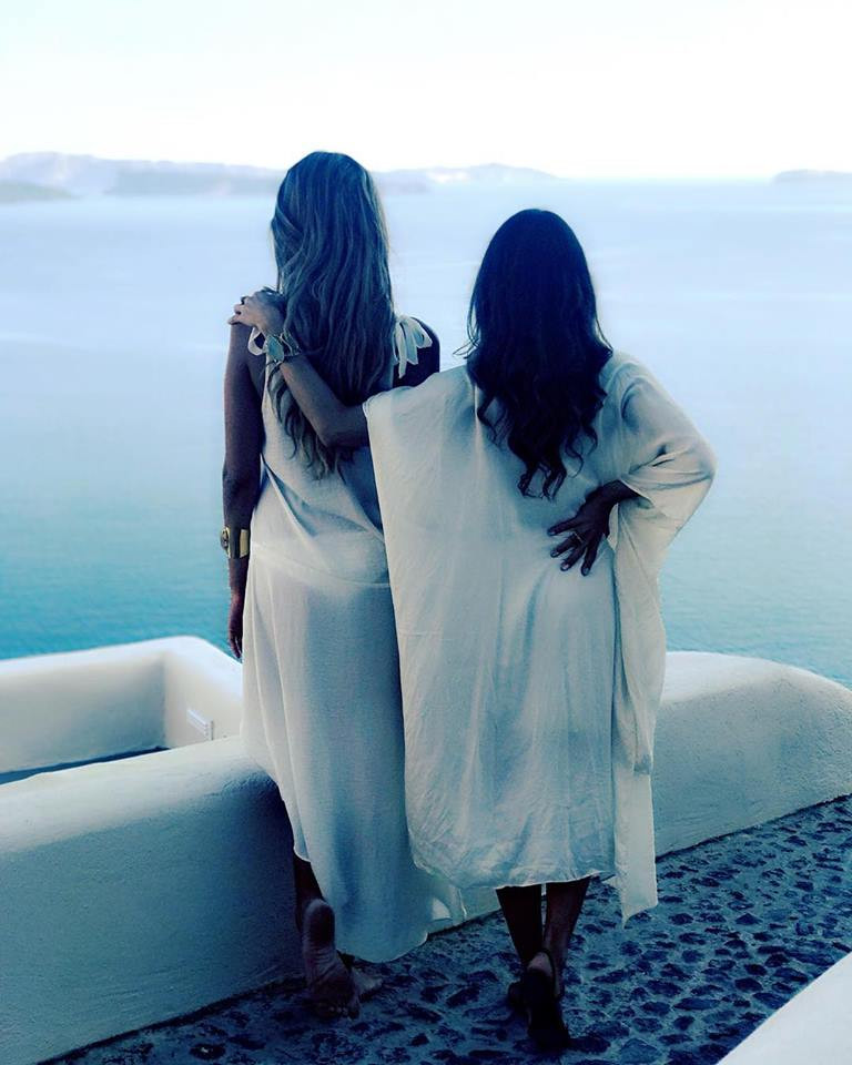two beautiful women looking out over the Aegean sea with Helenika Travels
