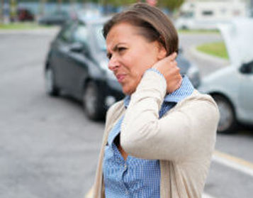 woman-grabbing-neck-after-car-crash-blog