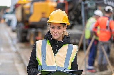 female construction worker managing team