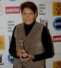 UNACCOMPANIED Linda holding award.jpg