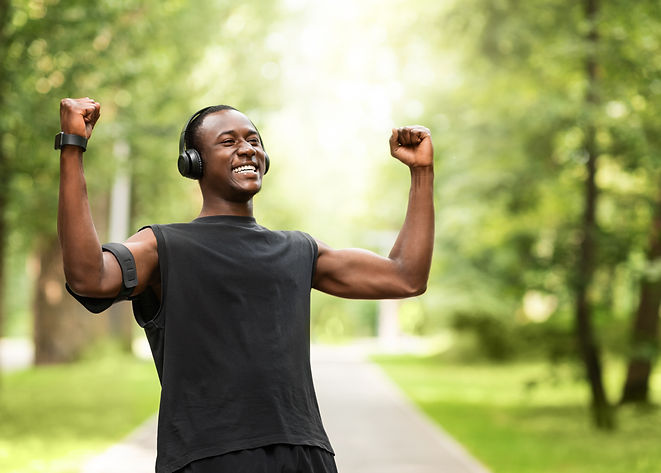 black-sportsman-celebrating-success-trai
