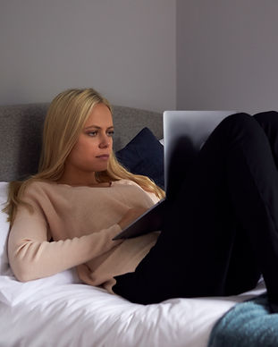 unhappy-woman-at-home-with-computer-bein