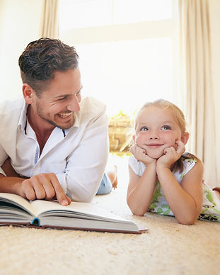 father-with-two-kids-reading-a-story-boo