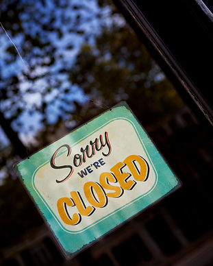 closed-sign-on-a-french-shop-window-PZC4