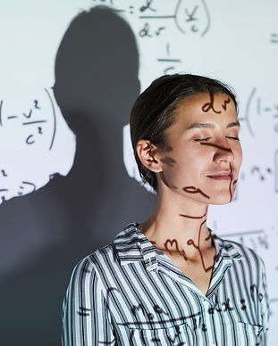 lady-against-projection-screen-with-math