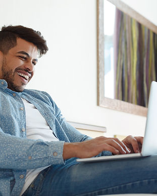 young-man-chatting-on-laptop-with-friend