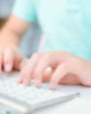 human-hands-pushing-keys-of-computer-key