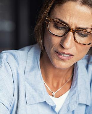 stressed-woman-wearing-eyeglasses-rp6qla