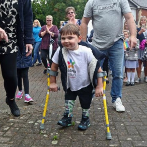 Small boy with prosthetic legs raises £1 million