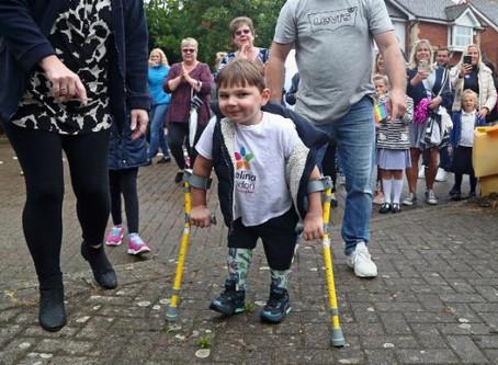 Small boy with prosthetic legs raises £1 million