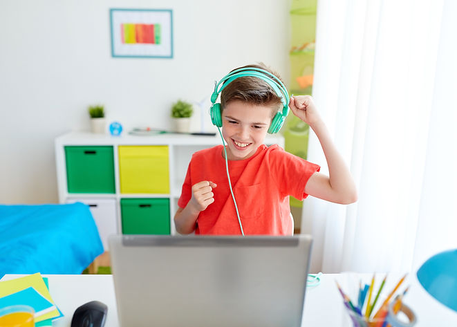 boy-in-headphones-playing-video-game-on-