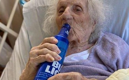 103-year-old survivor celebrates with a beer