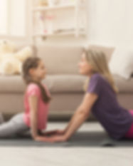 young-woman-and-child-daughter-doing-yog