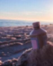 Sunset illuminating time capsule bottle