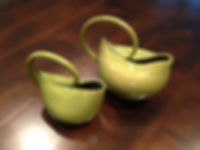 Organically inspired thrown and altered set of pitchers with pulled handles, in Speckled Olive glaze at Dan Harelick Studio Art