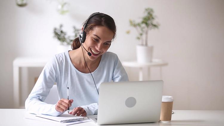 Happy woman in headphones speaking by we