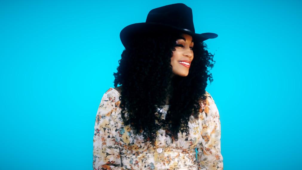 zaina headshot cowgirl.jpg