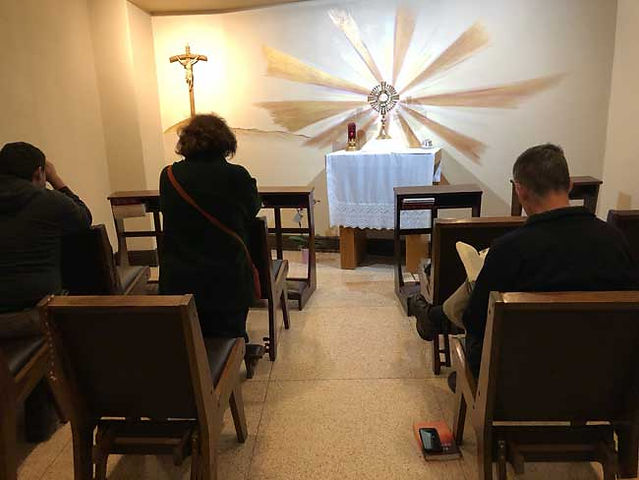 Adoration chapel at St. Therese with worshipers and monstrance