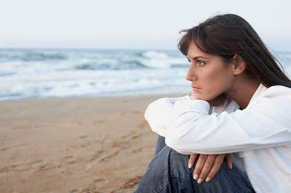 woman thinking about life by the ocean