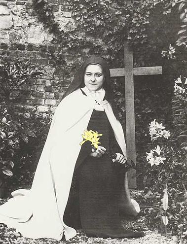 Therese of the Child Jesus seated in the garden at the Carmelite convent at Lisieux