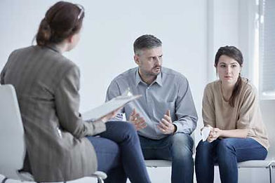 therapist across from couple in disagreement