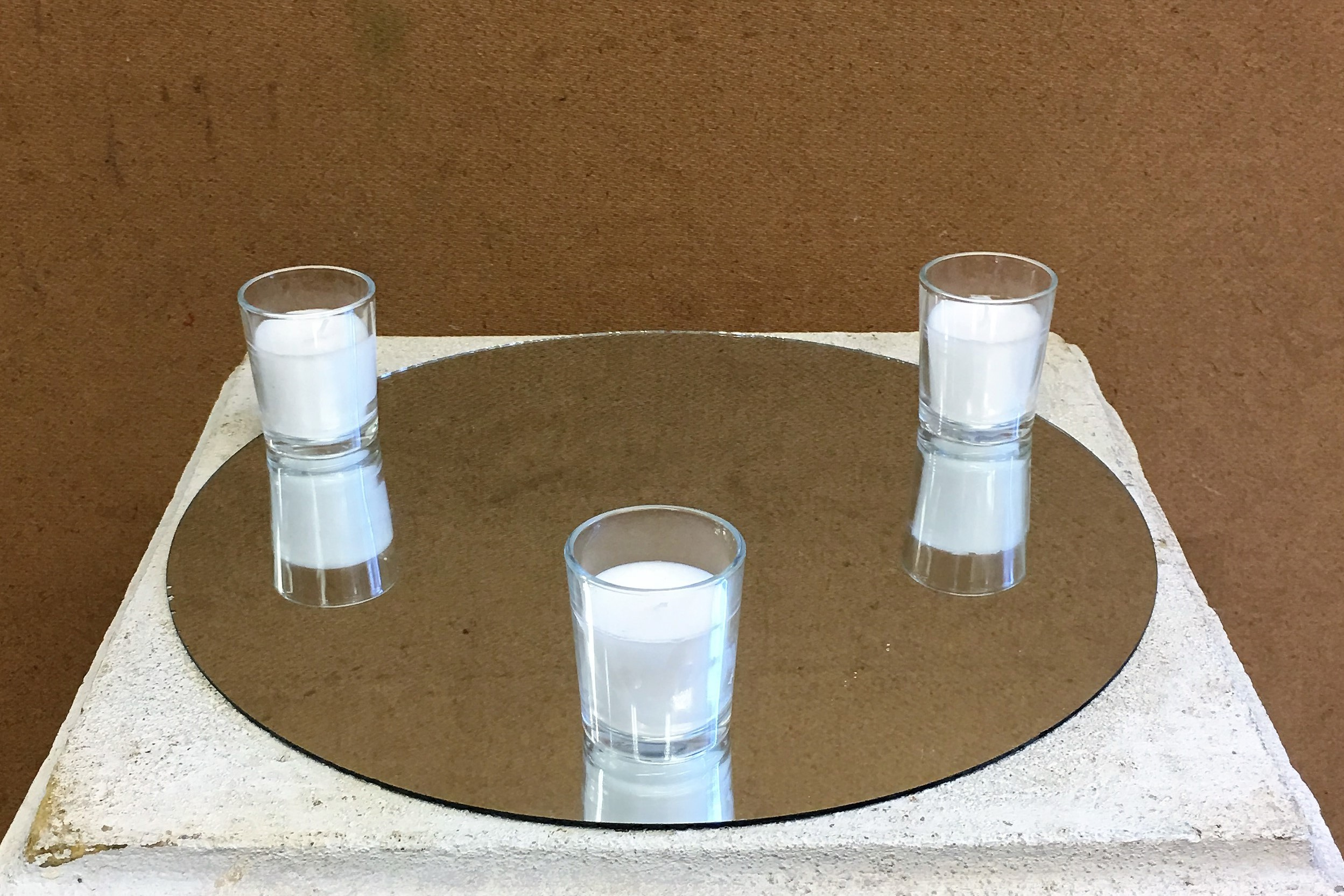 Round Mirror and Votive Candles