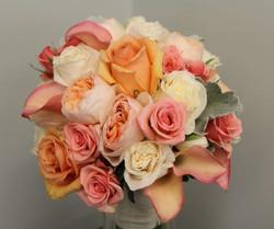 cream and peach roses and callas