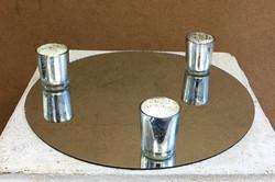 Round Mirror and Votive Candles