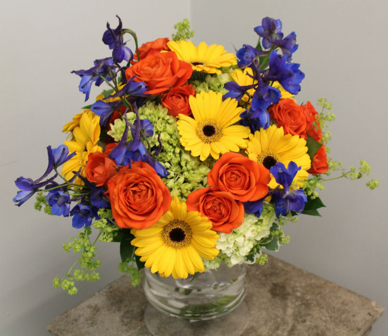 orange yellow green and blue bouquet