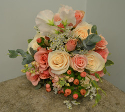 peach and cream with greenery
