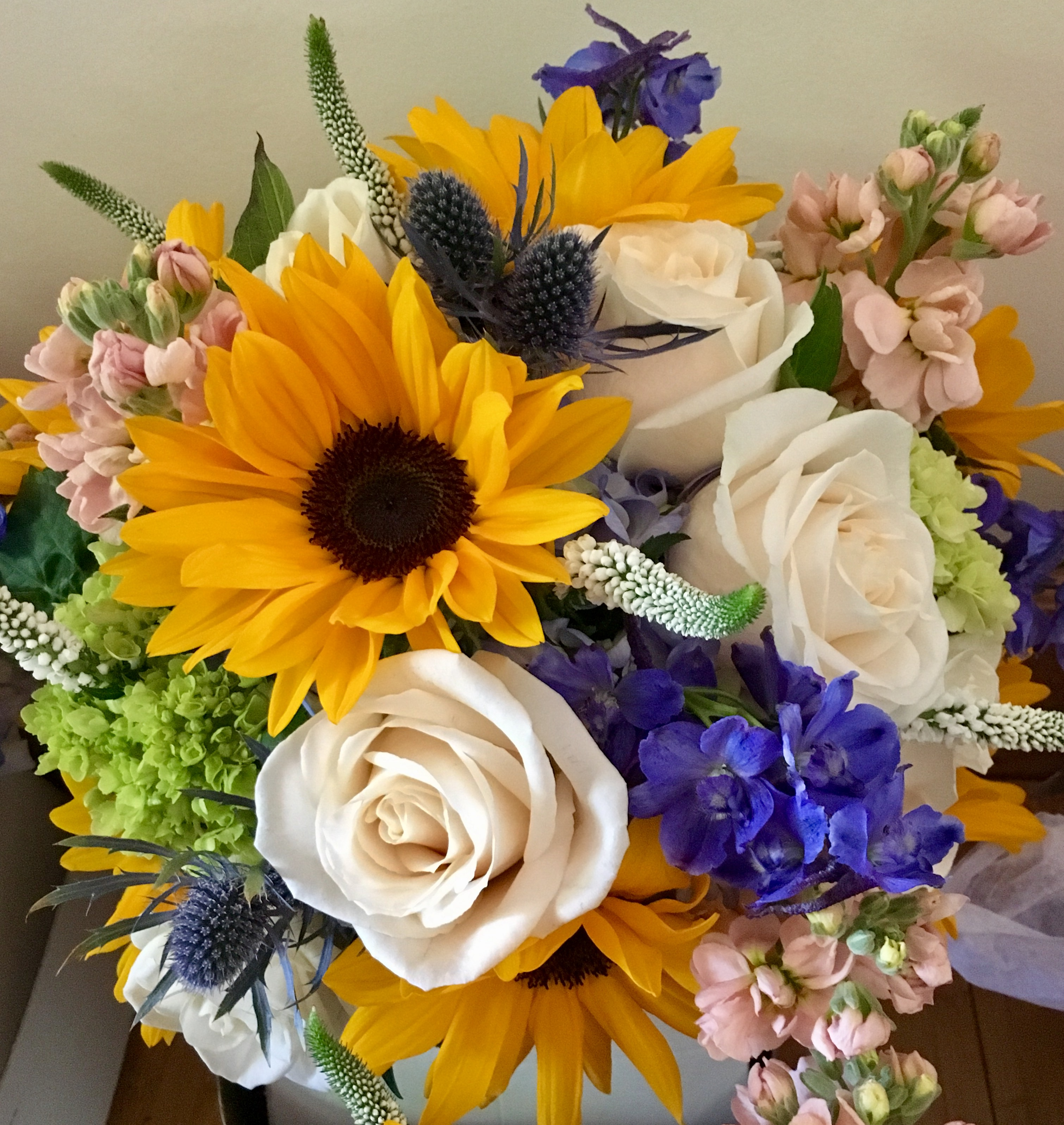yellow peach blue and green bouquet