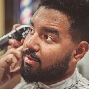 Portrait of unshaven black man getting n