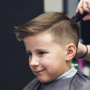 European boy  getting hairstyle in barbe