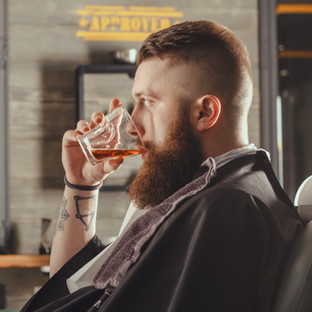 Serious Young Bearded Man Sitting In Cha