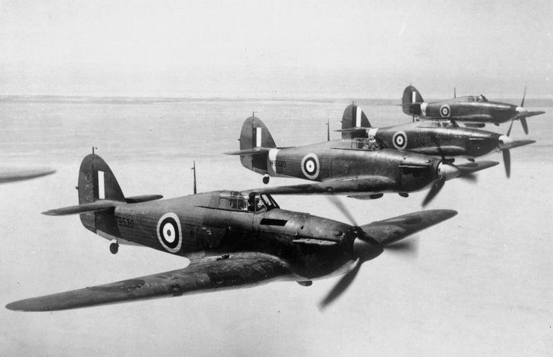 Four Aircraft of the Royal Air Force, Hurricane Mark Is, T9530, W9320, W9349 and Z4095, in port echelon formation during a test flight, 1939-1945.