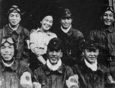 Photograph of Torihama Tome, mother of Reiko Akabane, with kamikaze pilots outside her restaurant