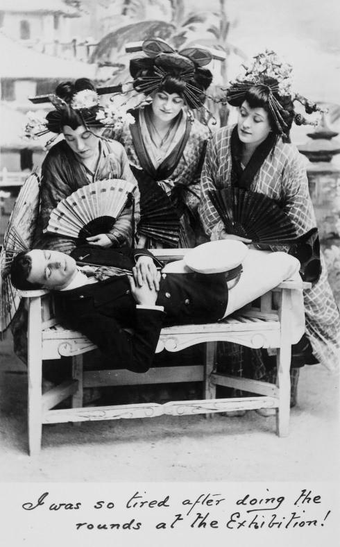 A trio of Edwardian women dressed as geisha's posing with an Edwardian Gentleman.