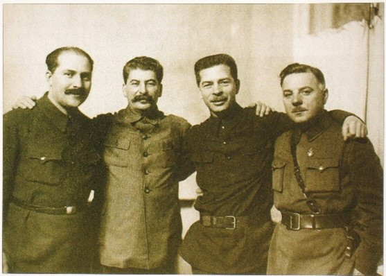 Figure 13: L. to r. Kaganovitch, Stalin and Postychev, with Kliment Voroshilov, head of the Red Army, 1934
