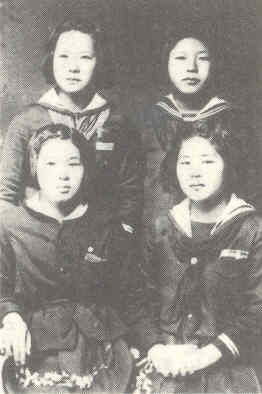 Waving girls from Chiran Air Base, including Reiko Akabane, daughter of Torihame Tome, in the front right.
