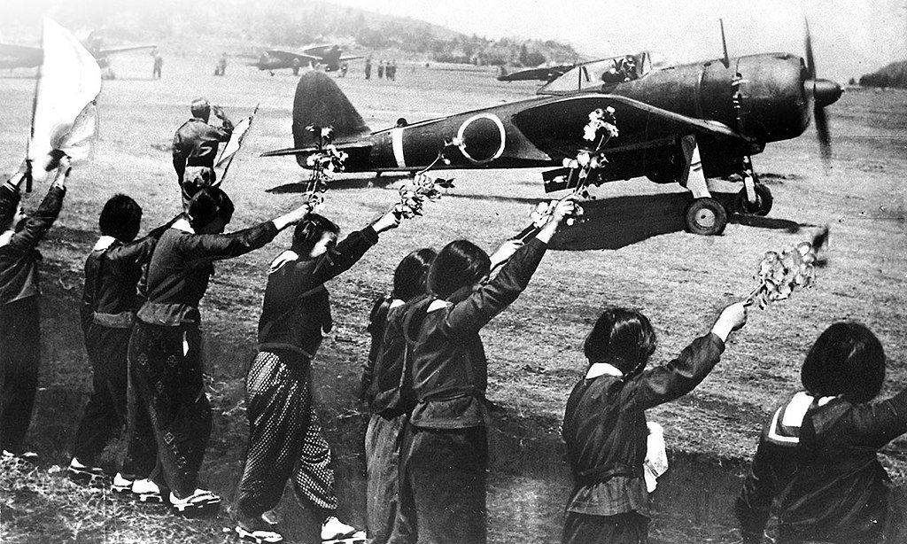 Pilot taking off from Chiran Air Base being bid farewell by Waving Girls holding blossom branches