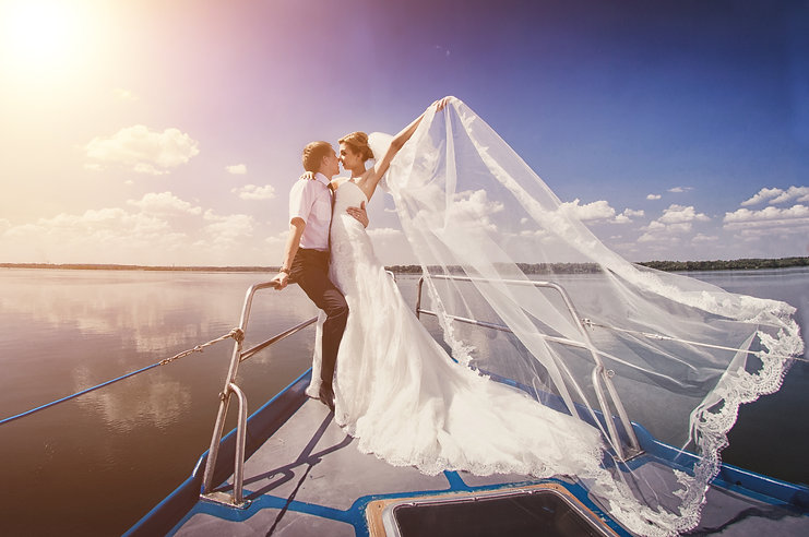 Just married couple on yacht. Happy brid