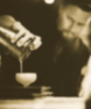 Closeup of a bartender pouring a cocktail