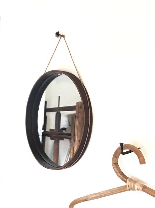 Leather-edged round mirror